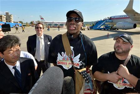 Former basketball star Dennis Rodman (C) arrives at Pyongyang airport, in this photo taken by Kyodo September 3, 2013. REUTERS/Kyodo