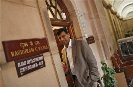 India's chief economic adviser Raghuram Rajan stands outside his room at the finance ministry in New Delhi August 6, 2013. REUTERS/Adnan Abidi
