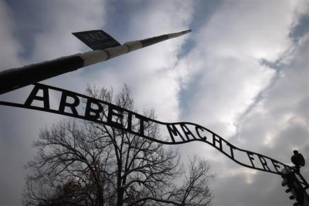 The sign ''Arbeit macht frei'' at the main gate to the Auschwitz concentration camp is seen on January 27, 2013. REUTERS/Peter Andrews