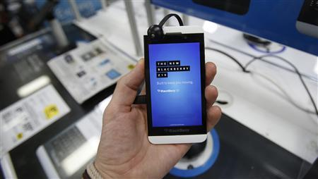 A Blackberry Z10 smartphone is held up in Pasadena, California July 8, 2013. REUTERS/Mario Anzuoni