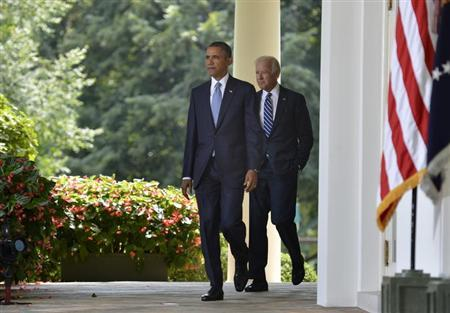 U.S. President Barack Obama walks with Vice President Joe Biden (R) to the Rose Garden of the White House to make remarks on the situation in Syria, August 31, 2013, in Washington. REUTERS/Mike Theiler