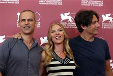 "Actress Scarlett Johansson (C) poses with director Jonathan Glazer (R) and producer James Wilson (L) during a photocall for the movie ""Under the Skin"" during the 70th Venice Film Festival in Venice September 3, 2013. REUTERS/Alessandro Bianchi"
