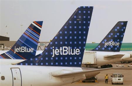 JetBlue Airways aircraft are pictured at departure gates at John F. Kennedy International Airport in New York June 15, 2013. REUTERS/Fred Prouser