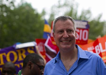 New York mayoral candidate Bill de Blasio participates in a march during the West Indian Day Parade in the Brooklyn borough of New York September 2, 2013. Picture taken September 2, 2013. REUTERS/Eric Thayer