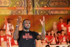 NBA basketball player LeBron James of the Miami Heat gestures as he attends a promotional event at the Imperial Ancestral Temple in Beijing, July 27, 2013. REUTERS/China Daily