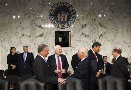 Senators John McCain (R-AZ) (center), Tim Kaine (D-VA) and Ben Cardin (D-MD) (right) speak before Chairman of the Joint Chiefs General Martin E. Dempsey, John Kerry, U.S. secretary of state, and Charles 'Chuck' Hagel, secretary of defense, arrive to present the administration's case for U.S. military action against Syria to a Senate Foreign Relations Committee hearing on September 3, 2013. REUTERS/Joshua Roberts