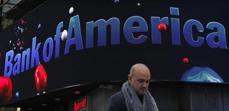 A man walks next to a Bank of America branch in New York October 24, 2012. REUTERS/Eduardo Munoz
