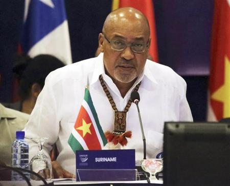 Suriname's President Desi Bouterse speaks during a working session at a Union of South American Nations (UNASUR) leaders summit, in Paramaribo August 30, 2013. REUTERS/Ranu Abhelakh