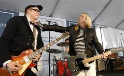 Lead singer Robin Zander (R) fixes the bowtie of lead guitarist Rick Nielsen as they perform with their band Cheap Trick at the 6th annual John Varvatos Stuart House Benefit in West Hollywood, California in this March 9, 2008 file photo. REUTERS/Mario Anzuoni