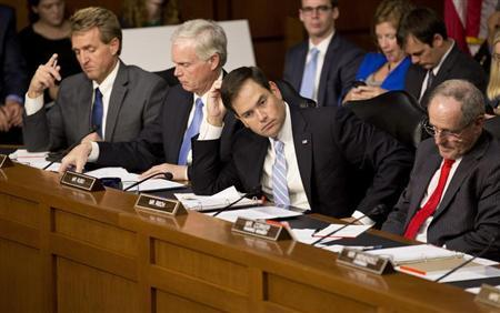 (L-R) Senators Jeff Flake (R-AZ), Ron Johnson (R-WI), Marco Rubio (R-FL) and James Risch (R-ID) listen as (not pictured) U.S. Defense Secretary Chuck Hagel, U.S. Secretary of State John Kerry and General Martin E. Dempsey , chairman of the Joint Chiefs of Staff, present the administration's case for U.S. military action against Syria to a Senate Foreign Relations Committee hearing in Washington September 3, 2013. REUTERS/Joshua Roberts