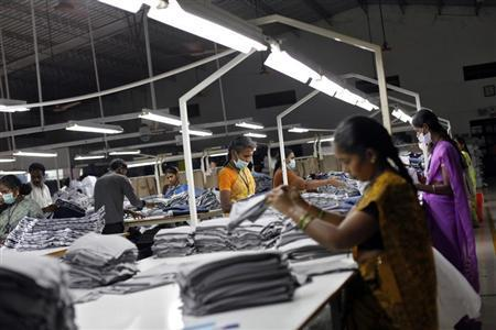 Employees sort clothes before packing them at the Estee garment factory in Tirupur, in the southern Indian state of Tamil Nadu June 19, 2013. REUTERS/Mansi Thapliyal