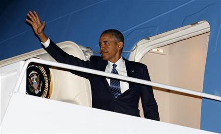 U.S. President Barack Obama boards Air Force One at Joint Base Andrews in Washington enroute to Stockholm, before heading to Russia for the G20 summit, September 3, 2013. REUTERS/Kevin Lamarque
