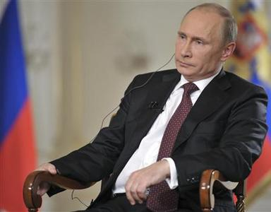 Russian President Vladimir Putin gives an interview at the Novo-Ogaryovo state residence outside Moscow September 3, 2013. REUTERS-Alexei Druzhinin-RIA Novosti-Kremlin