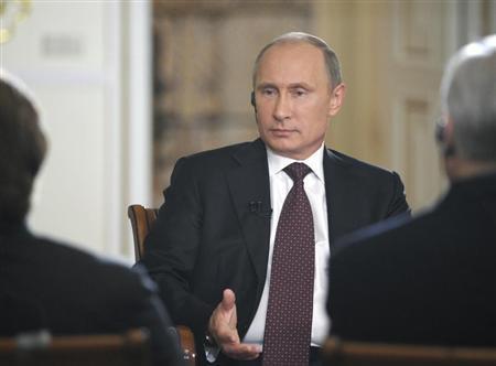 Russian President Vladimir Putin speaks during an interview at the Novo-Ogaryovo state residence outside Moscow September 3, 2013. REUTERS/Alexei Druzhinin/RIA Novosti/Kremlin