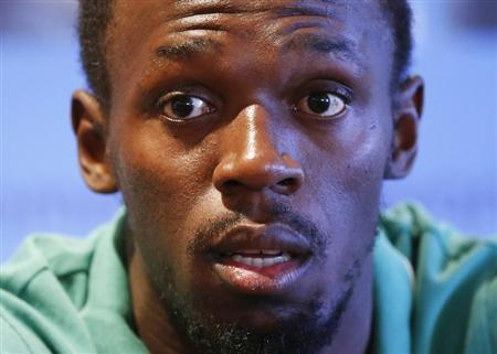 Jamaican sprinter Usain Bolt addresses a news conference ahead of the IAAF Diamond League athletics meeting, also known as Memorial Van Damme, in Brussels September 4, 2013. REUTERS/Francois Lenoir