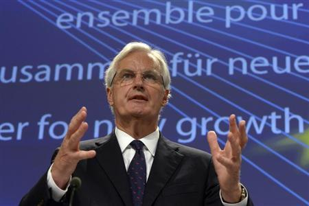 European Union Commissioner for Internal Market and Services Michel Barnier gestures during a joint news conference with European Union Competition Commissioner Joaquin Almunia (not pictured) about a cap to the costs of processing card payments in Brussels July 24, 2013. REUTERS/Eric Vidal