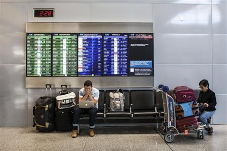 Passengers wait for their delayed flights after an Asiana Airlines Boeing 777 crashed and burst into flames as it landed at San Francisco International Airport in San Francisco, California July 6, 2013. REUTERS/Jana Asenbrennerova