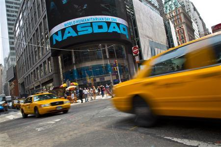 Taxi cabs drive past the Nasdaq MarketSite in New York's Times Square, August 23, 2013. REUTERS/Andrew Kelly