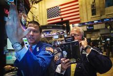 Wall Street termine en hausse mercredi, pour la deuxième séance d'affilée, ayant récupéré l'essentiel des pertes liées à la Syrie de la semaine passée à la faveur d'excellents chiffres des ventes automobiles aux Etats-Unis. L'indice Dow Jones gagne 0,65%, le S&P-500 prend 0,81% et le Nasdaq Composite avance de points 1,01%. /Photo prise le 4 septembre 2013/REUTERS/Lucas Jackson