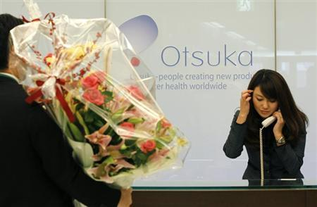 A flower arrangement to celebrate Otsuka Holdings Co's listing on the Tokyo Stock Exchange is delivered at the company headquarters in Tokyo December 15, 2010. REUTERS/Toru Hanai