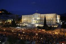 Demonstrators stand during a protest in front of the parliament in Athens July 17, 2013. REUTERS/Yannis Behrakis