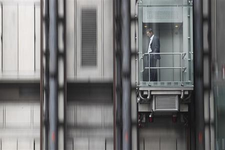A man descends in an elevator at the Lloyds of London insurance building in London, September 28, 2010. REUTERS/Andrew Winning