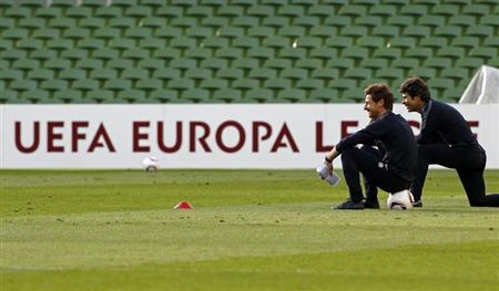 Porto's soccer coach Andre Vilas-Boas (L) watches the training session, accompanied by assistant coach Jose Mario Rocha, at Dublin Arena in this May 17, 2011 file photo. REUTERS/Jose Manuel Ribeiro/Files