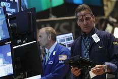 Wall Street a signé jeudi une troisième séance de hausse d'affilée, à la faveur de statistiques économiques positives, mais les gains ont été modestes à la veille de la publication des chiffres de l'emploi d'août qui seront peut-être déterminants pour la politique monétaire de la Réserve fédérale. L'indice Dow Jones des 30 industrielles a grignoté 0,04% et le Standard & Poor's 500 a pris 0,12%. Le Nasdaq Composite, à forte pondération technologique, a avancé de 0,27%. /Photo prise le 5 septembre 2013/REUTERS/Brendan McDermid