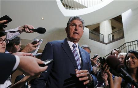 U.S. Senator Joe Manchin (D-WVa) departs after a classified intelligence briefing with members of Congress on the crisis in Syria on Capitol Hill in Washington, September 5, 2013. REUTERS/Larry Downing