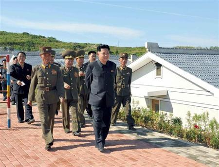North Korean leader Kim Jong-un (front) is pictured during his inspection of the defence detachment on Jangjae Islet and the Hero Defence Detachment on Mu Islet in this undated photo released by North Korea's Korean Central News Agency (KCNA) in Pyongyang September 3, 2013. REUTERS/KCNA