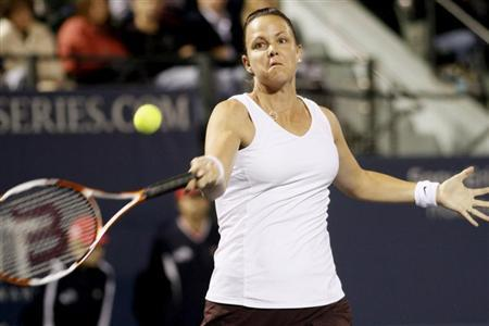 Lindsay Davenport of the U.S. returns a shot to Britain's Sarah Borwell and Raquel Kops-Jones of the U.S. during their Stanford Classic women's doubles semi-final match in Stanford, California in this July 31, 2010 file photo. REUTERS/Kevin Bartram