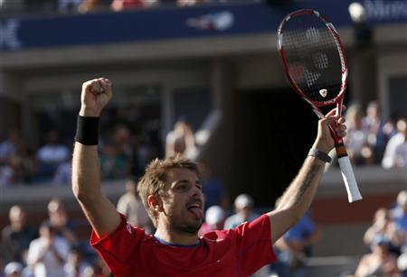 Stanislas Wawrinka of Switzerland celebrates winning match point against Andy Murray of Britain at the U.S. Open tennis championships in New York September 5, 2013. REUTERS/Mike Segar