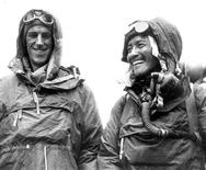 Sir Edmund Hillary (L) and Tenzing Norgay Sherpa display their climbing gear at the British Embassy in Kathmandu following their conquest of Mount Everest in 1953 in this undated handout photograph. REUTERS/Picture Norgay Archive/Handout
