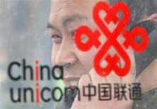 A man uses a China Unicom public telephone in Beijing March 21, 2013. REUTERS/Kim Kyung-Hoon