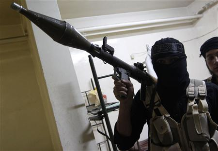 A Free Syrian Army fighter poses for a picture as he holds an RPG launcher in Raqqa province, eastern Syria September 4, 2013. Picture taken September 4, 2013. REUTERS/Nour Fourat