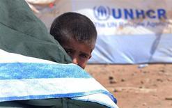 Мальчик в лагере сирийских беженцев в Ираке 23 августа 2013 года. США заявили в четверг о прекращении попыток выработать единое решение по Сирии в Совете безопасности ООН и обвинили Россию в том, что она блокирует его работу и позволяет своим сирийским союзникам убивать невинных детей. REUTERS/Stringer