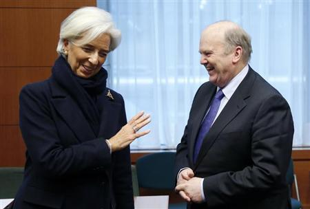 International Monetary Fund (IMF) Managing Director Christine Lagarde talks to Ireland's Finance Minister Michael Noonan (R) during an euro zone finance ministers meeting at the European Union Council in Brussels February 11, 2013. REUTERS/Francois Lenoir
