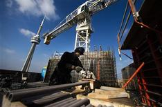 """A construction worker works on the """"ICE Condominiums"""" development site by Cadillac Fairview and Lanterra Developments in Toronto December 14, 2012. REUTERS/Mark Blinch"""