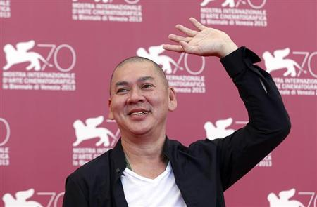 Director Tsai Ming-Liang, poses during a photocall for the movie ''Stray Dogs'', directed by him, during the 70th Venice Film Festival in Venice September 5, 2013. REUTERS/Alessandro Bianchi
