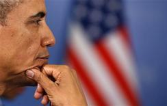 Президент США Барак Обама на саммите G20 в Петербурге 6 сентября 2013 года. Обама выстоял под давлением со стороны части мировых лидеров, взывающих к отказу от авиаудара по Сирии, что углубило раскол, мешающий совместными усилиями оживить мировую экономику. REUTERS/Kevin Lamarque