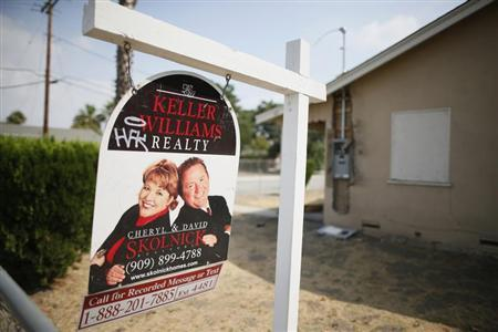 A real estate sign is seen outside a deserted home stripped of its copper wiring in San Bernardino, California September 11, 2012. REUTERS/Lucy Nicholson