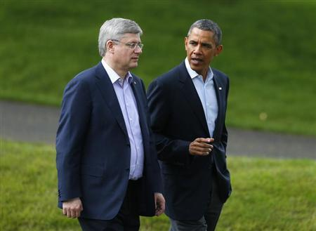 Canada's Prime Minister Stephen Harper (L) walks with U.S. President Barack Obama after a G8 summit group photograph was taken at the Lough Erne golf resort in Enniskillen, Northern Ireland June 18, 2013. REUTERS/Andrew Winning