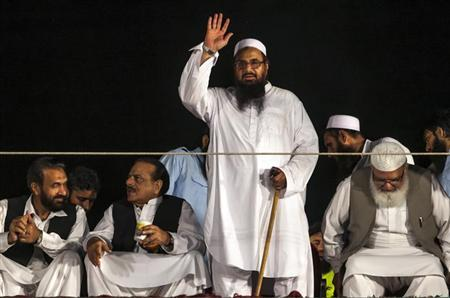 Hafiz Saeed, head of the Jamaat-ud-Dawa organisation and founder of Lashkar-e-Taiba, waves to his supporters during a rally marking Pakistan's Defense Day in Islamabad September 6, 2013. REUTERS/Faisal Mahmood