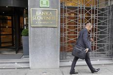 A man walks past Slovenia's Central Bank in Ljubljana July 15, 2011. REUTERS/Srdjan Zivulovic