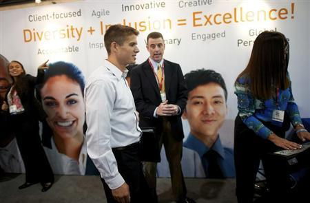 Recruiters speak with job-seekers at a career fair, part of the annual National Urban League Conference, in Philadelphia July 25, 2013. REUTERS/Mark Makela