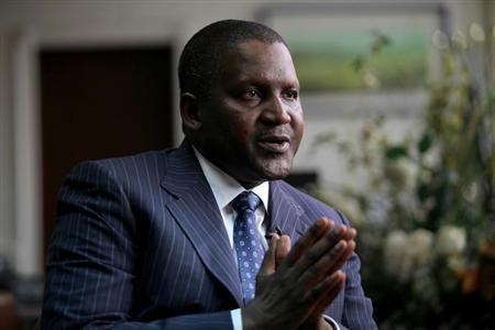 Founder and Chief Executive of the Dangote Group Aliko Dangote gestures during an interview with Reuters in his office in Lagos, June 13, 2012. REUTERS/Akintunde Akinleye