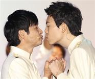 South Korean film director Kim Jho Gwang-soo (L) kisses his partner Kim Seung-hwan during their wedding ceremony in central Seoul September 7, 2013. REUTERS/Lee Jae-Won