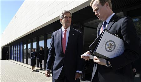U.S. Secretary of State John Kerry (C) is pictured with aide Jason Meininger as he leaves a meeting with European Union Ministers of Foreign Affairs at the National Gallery of Art in Vilnius, Lithuania, September 7, 2013. REUTERS/Susan Walsh/Pool