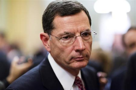 Senator John Barrasso (R-WY) speaks to the media after the Republican policy luncheon on Capitol Hill in Washington December 18, 2012. REUTERS/Joshua Roberts