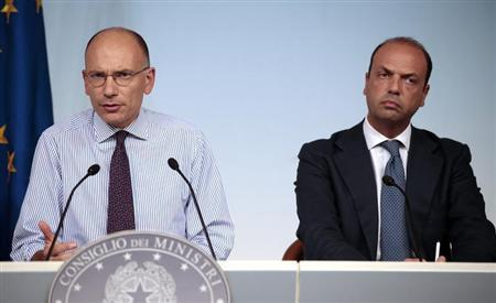 Italian Prime Minister Enrico Letta (L) and Deputy Prime Minister Angelino Alfano attend a news conference at the end of a cabinet meeting at Chigi palace in Rome August 28, 2013. REUTERS/Tony Gentile